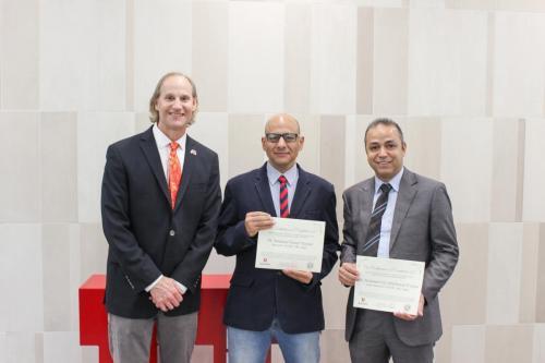 Drs. Hazman and El-Sayed receive certificates after completing the exchange program to Salt Lake City, Utah, USA