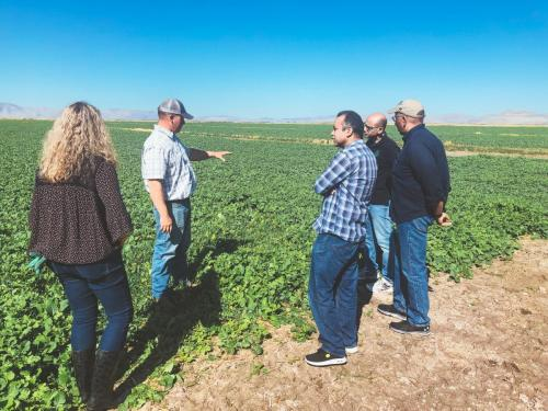 The team learning about cover crops from farmer Joel Ferry during a field visit in Utah